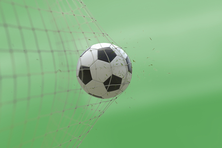 soccer ball in goal with grass leaves that raises effect on blur green background, concept of competition and leisure game equipment Standard-Bild - 107668860