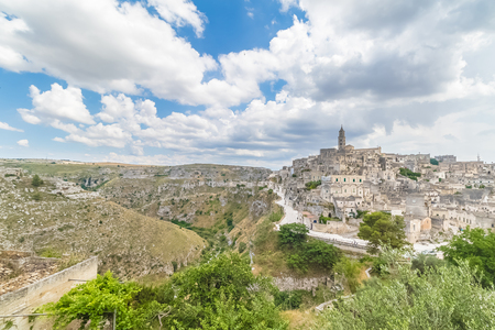 panoramic view of typical stones Sassi di Matera and church of Matera 2019 under blue sky with clouds,capital of europe culture 2019