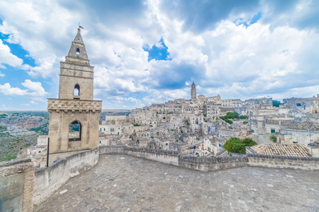 panoramic view of typical stones Sassi di Matera and church of Matera 2019 under blue sky with clouds, capital of europe culture 2019