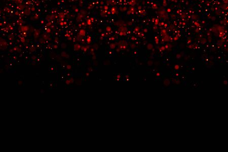 abstract waterfalls of red glitter sparkle bubbles particles bokeh on black background,christmas and happy new year holiday event Banco de Imagens