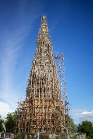 reconstruct: Repair the pagoda in a temple in Thailand.