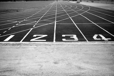 athletic track black and white photo