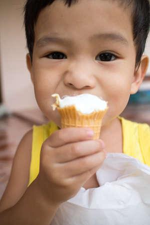 Asian children eating ice cream