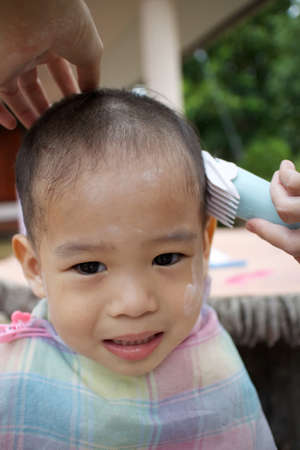 Boy haircut, Asia, Thailand. photo