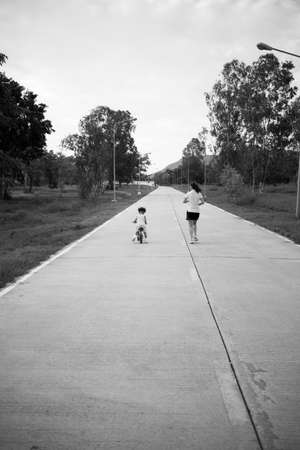 Mother and child exercising photo