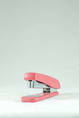 staple gun: Stapler pink Stock Photo