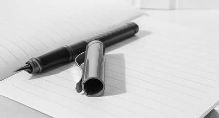a pen on notebook closeup view