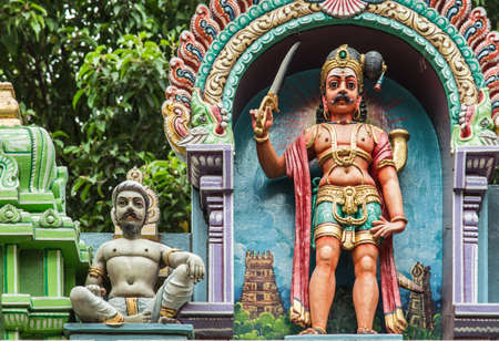 Indian style colorful sculpture in old temple Editorial