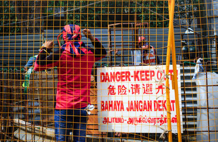 Singapore-02 APR 2019:worker wearing ac milan scarf in construction site