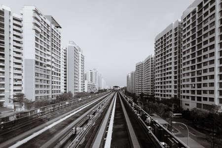 singapore LRT train railway pass through residential area Editorial
