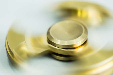 golden color metal spinner toy closeup view
