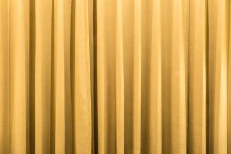 Detalle de fondo de cortina con ondas en tono cálido