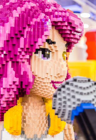 Singapore-26 SEP 2017: colorful Lego brick toy girl figure face closeup view Stok Fotoğraf