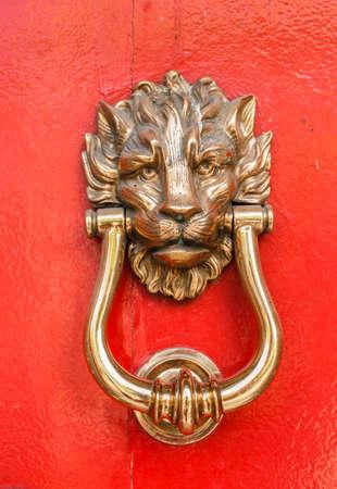 golden color lion vintage door knocker closeup