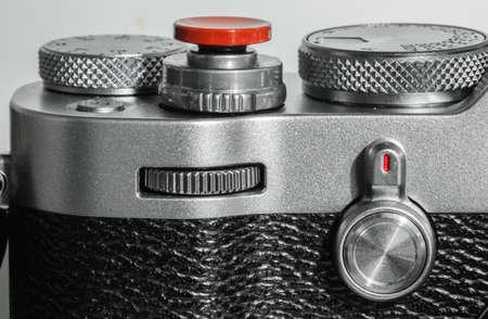 silver color camera shutter button and dial Stok Fotoğraf
