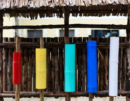 colorful bamboo container display on a wood wall