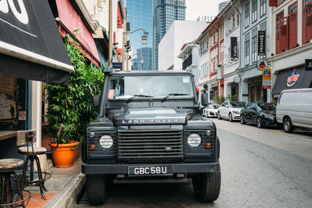 Singapore-09 JUN 2018: Off-road vehicle Land Rover parked in a traditional street