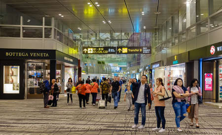 Singapore-03 APR 2018: People in Changi International Airport hall. Changi Airport serves more than 100 airlines operating 6,100 weekly flights