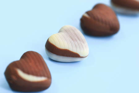 chocolate heart Valentines day on blue background for texture Banco de Imagens