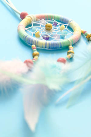 Close up of dream catchers on light blue background