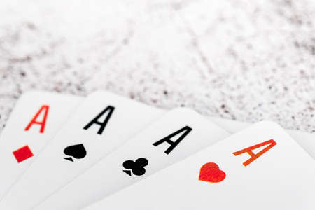 Four aces of different suits isolated on white background