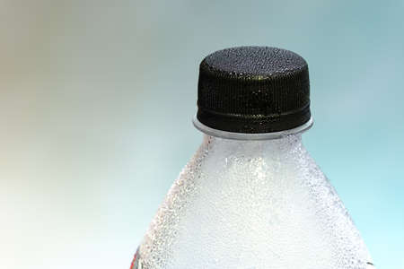 Close-up of plastic bottle, mineral water, bright background