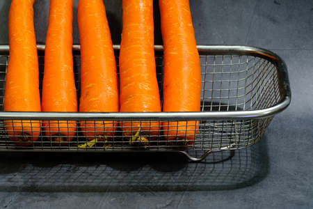 fresh baby carrot in basket isolated on black background Archivio Fotografico