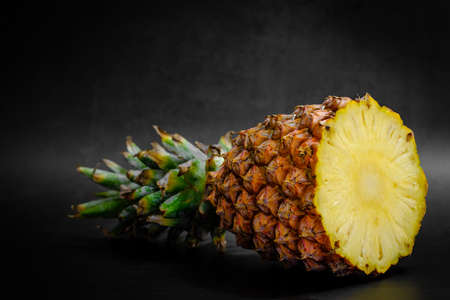 Pineapple on a black background with copy space