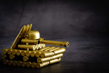 bullet shell toy tank on a black background Archivio Fotografico