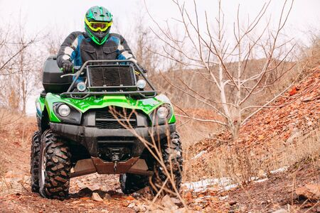 Rider driving in the quadbike race in winter in the forest Reklamní fotografie