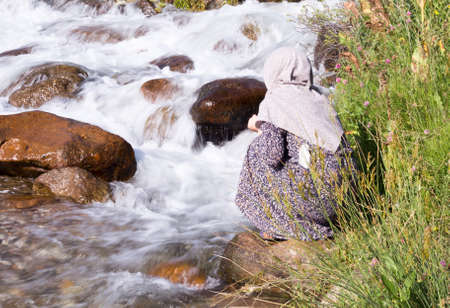 Muslim Woman near the river