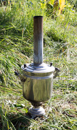 samovar: The samovar standing in a clearing in the smoke.