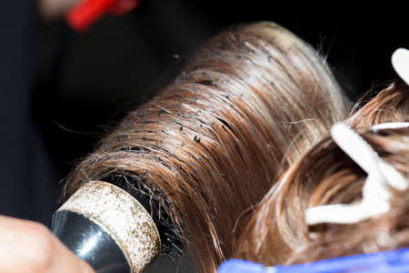 the process of hair styling in a beauty salon