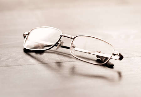 Glasses on a wooden floor Stock Photo