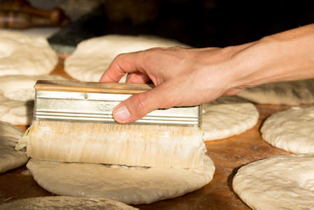 uzbek: process of preparing Uzbek bread Stock Photo