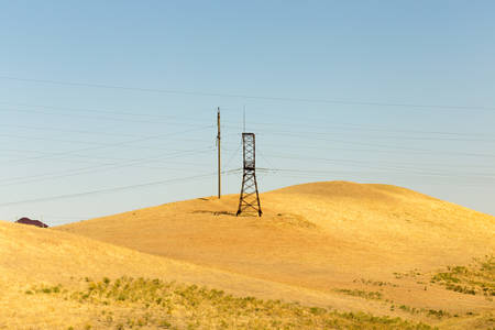 telephone poles: electric pole power lines and wires with blue sky