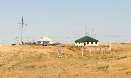 house in an open field Stock Photo
