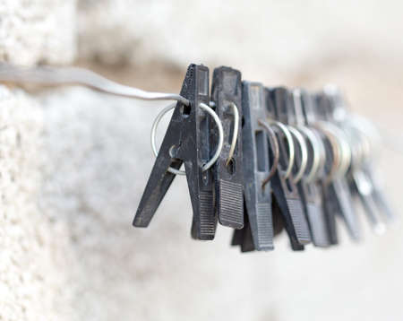 clothespegs: Black clothes-pegs on the rope