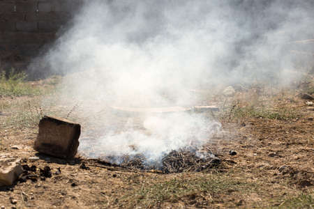 dump yard: Smoke and fire from during Burning of garden waste