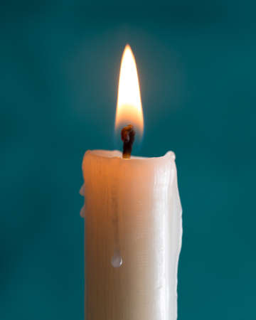 brightly lit: candle brightly lit on green background