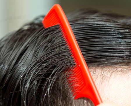 mirror image: man combing hair