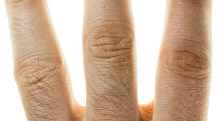 male finger close-up on a white background