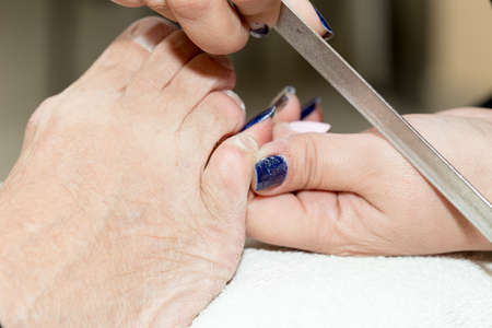 footcare: Pedicure in salon. The process of cleaning the feet Stock Photo