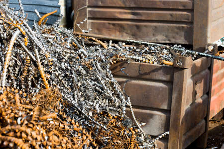 filings: silver spirals of metal shavings as garbage, texture of different size of metal spirals shavings texture, metal shavings texture
