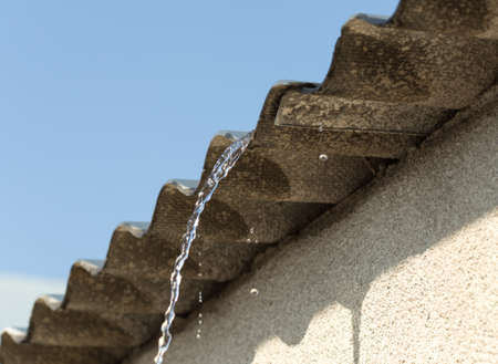 Water dripping from the roof Stock Photo
