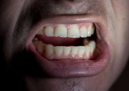 Mouth of a guy on a black background Reklamní fotografie