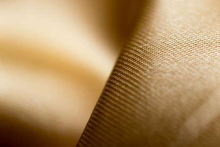 Background of yellow fabric silk macro