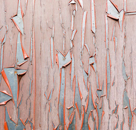 An old board. Over time, lamination cleared from old boards and cracked, wood texture, background, colorful, cracked, vintage, abstract, grunge
