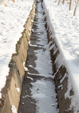 Snow cover on a concrete sewer