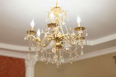 gilded chandelier on the ceiling Stock Photo